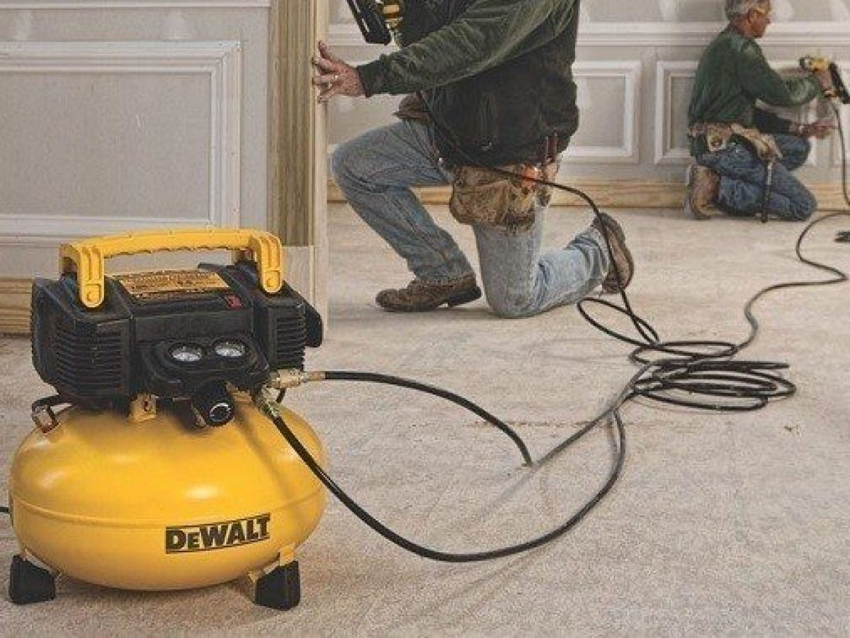 Pancake air compressor being used for trim work